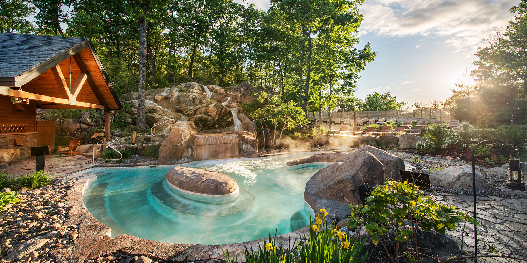 image tub construction by experts and curved with company hot improvement traditional waterfall natural deck patio living aquatic pool boulders home hardscape outdoor